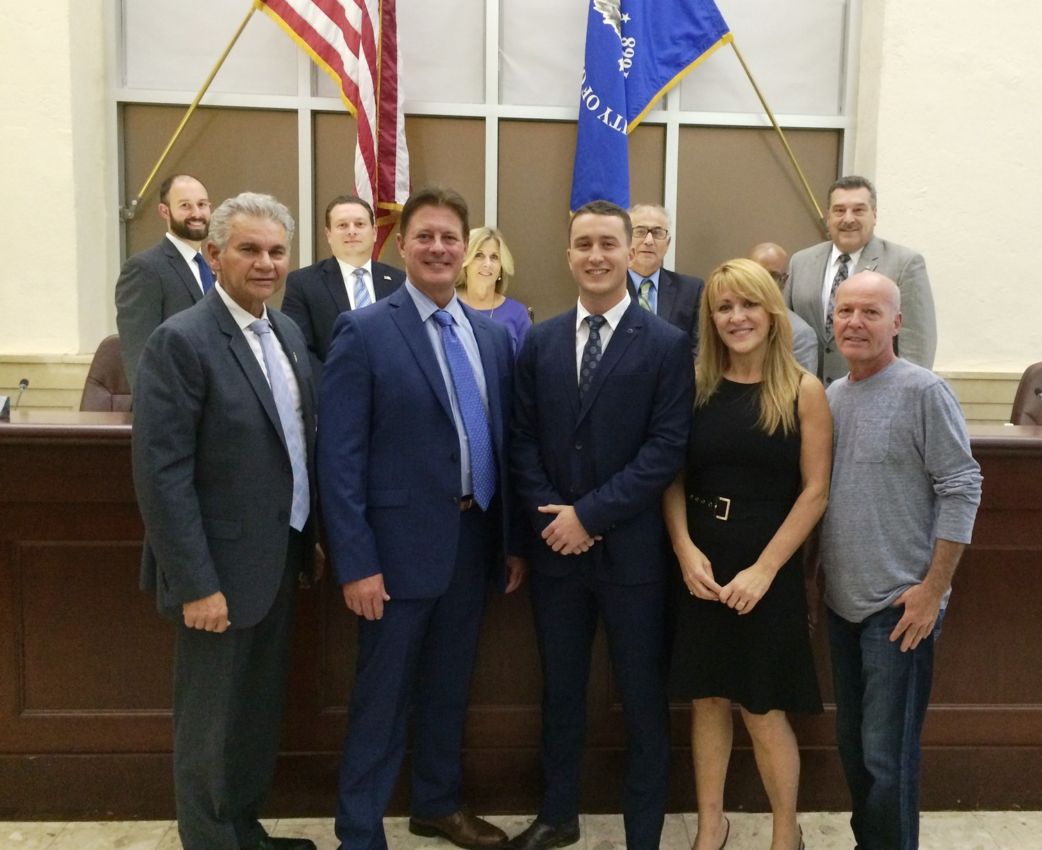 Mayor Reggie Spinello, far left, GCPD Chief William Whitton, and the City Council, welcomed new Glen Cove Police Recruit Marcello Zuccaro, front center, to the department, along with his parents Antonia and Giuseppe.