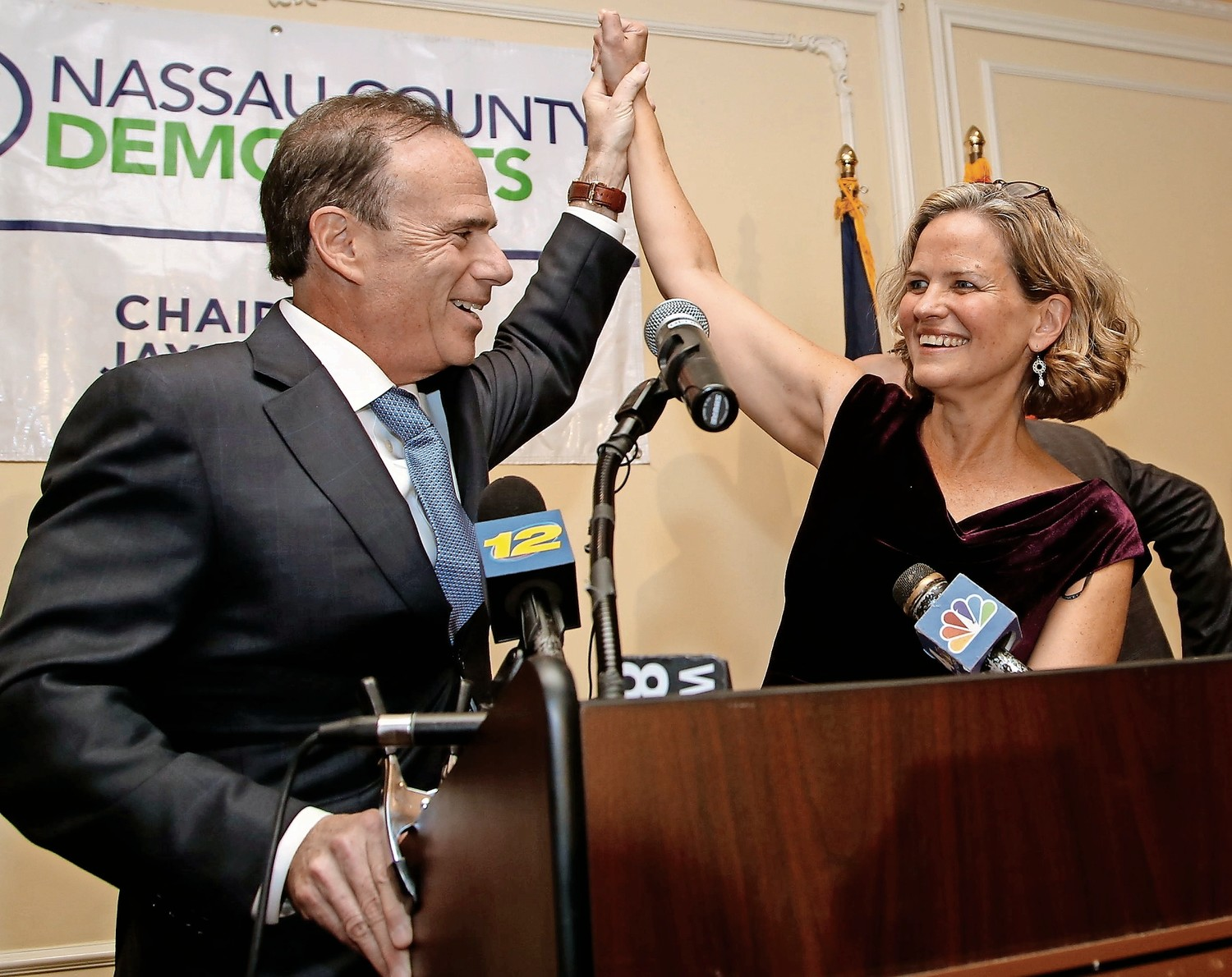 county executive-elect laura Curran, the first woman ever to claim that title, celebrated with Jay Jacobs, the Nassau County Democratic chairman, on Tuesday night.