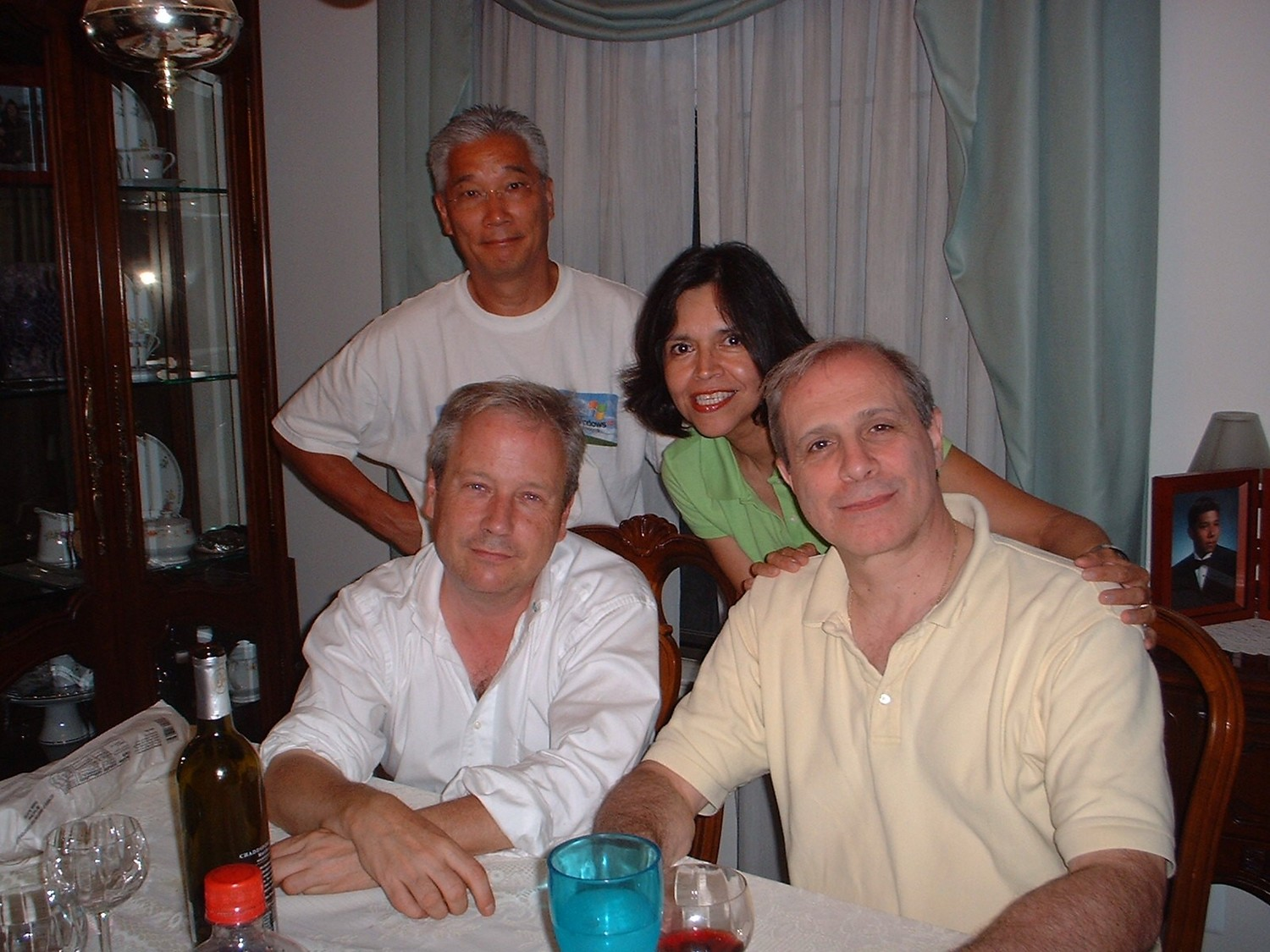Leonard Durso, second from left, grew up in Lynbrook with his foster brother Johnny Ding, left, and his brother Robert McMannis. Also pictured is his sister-in-law Cecelia Ding.