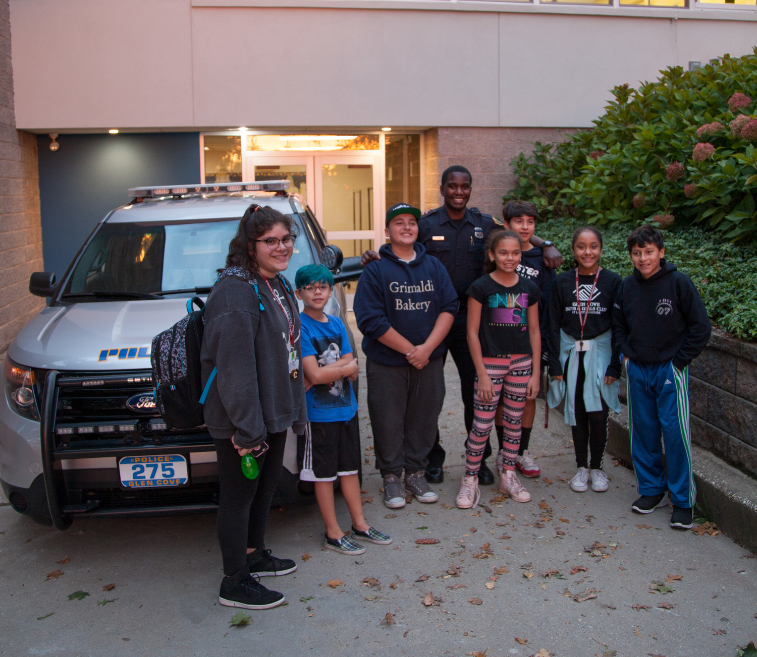 Glen Cove Police Officer Pittman showed the kids a police vehicle at the GCB&GC Lights on Afterschool event on Oct. 26.