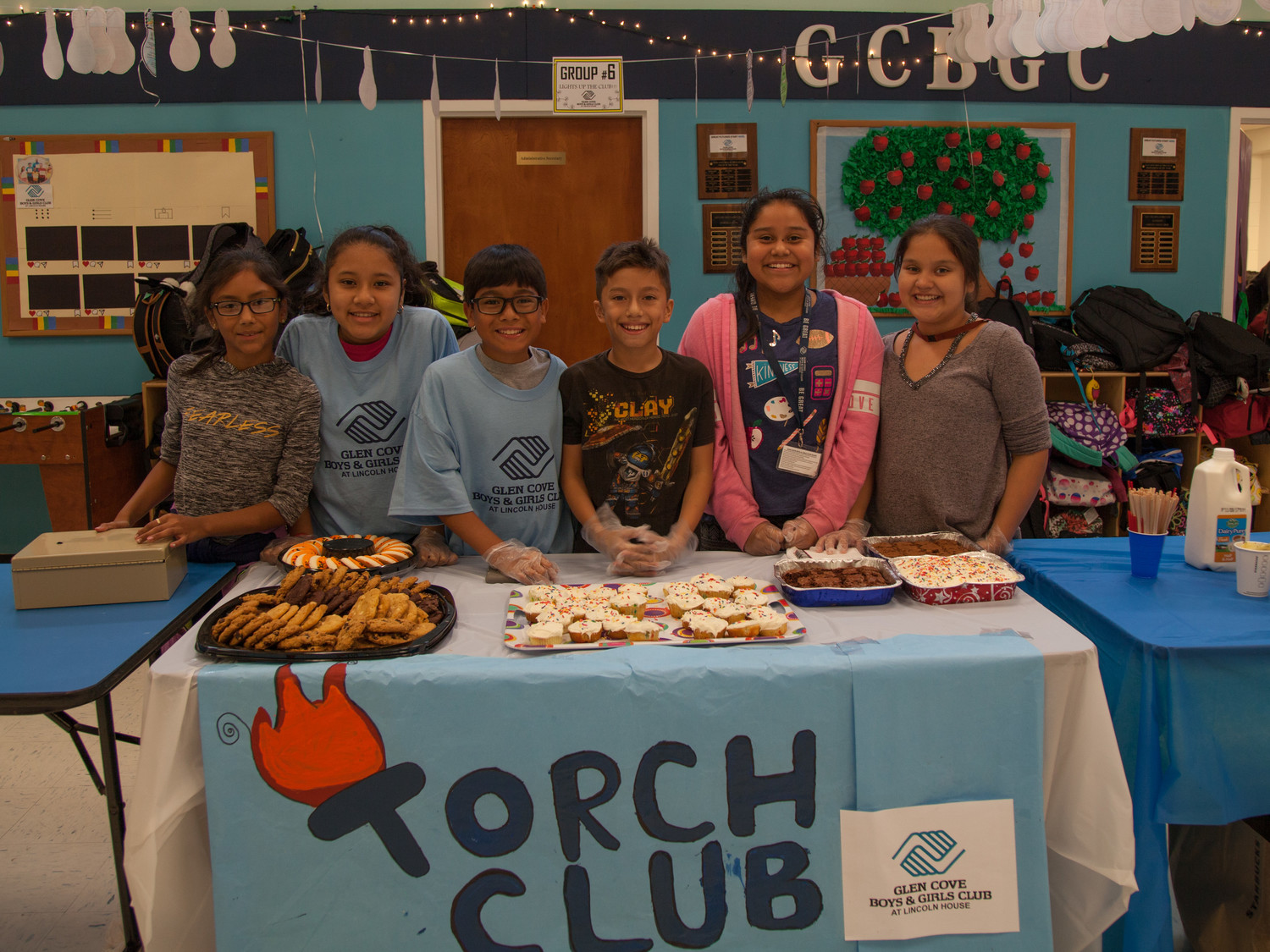 Angie Mendoza, left, Yesica Valladares, Daniel Hernandez, Jabier Escobar, Yamna Vigil, and Ashley Najarro sold baked goods for the GCB&GC's Torch Club at the Lights on Afterschool.