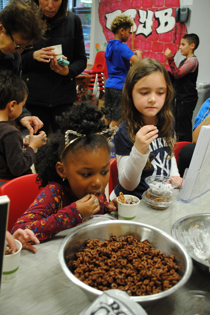 Ma'zeona Peterson, 6, and Maya Miller, 6, made snacks with Glen Cove Hospital's Chef Manager Claire Fastenau, who came to the Youth Bureau for its Lights on Afterschool event on Oct. 27.
