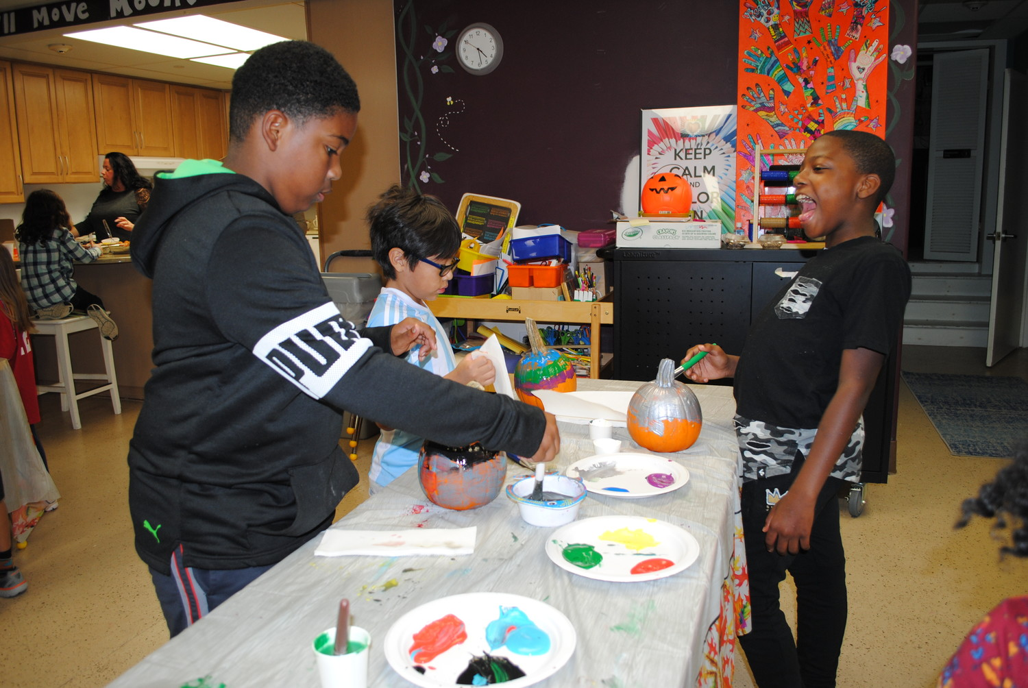 Chris Diggs, 10, Derek Polo, 7, and Derrick Brown, 10, decorated pumpkins at the Youth Bureau's Lights on Afterschool event.