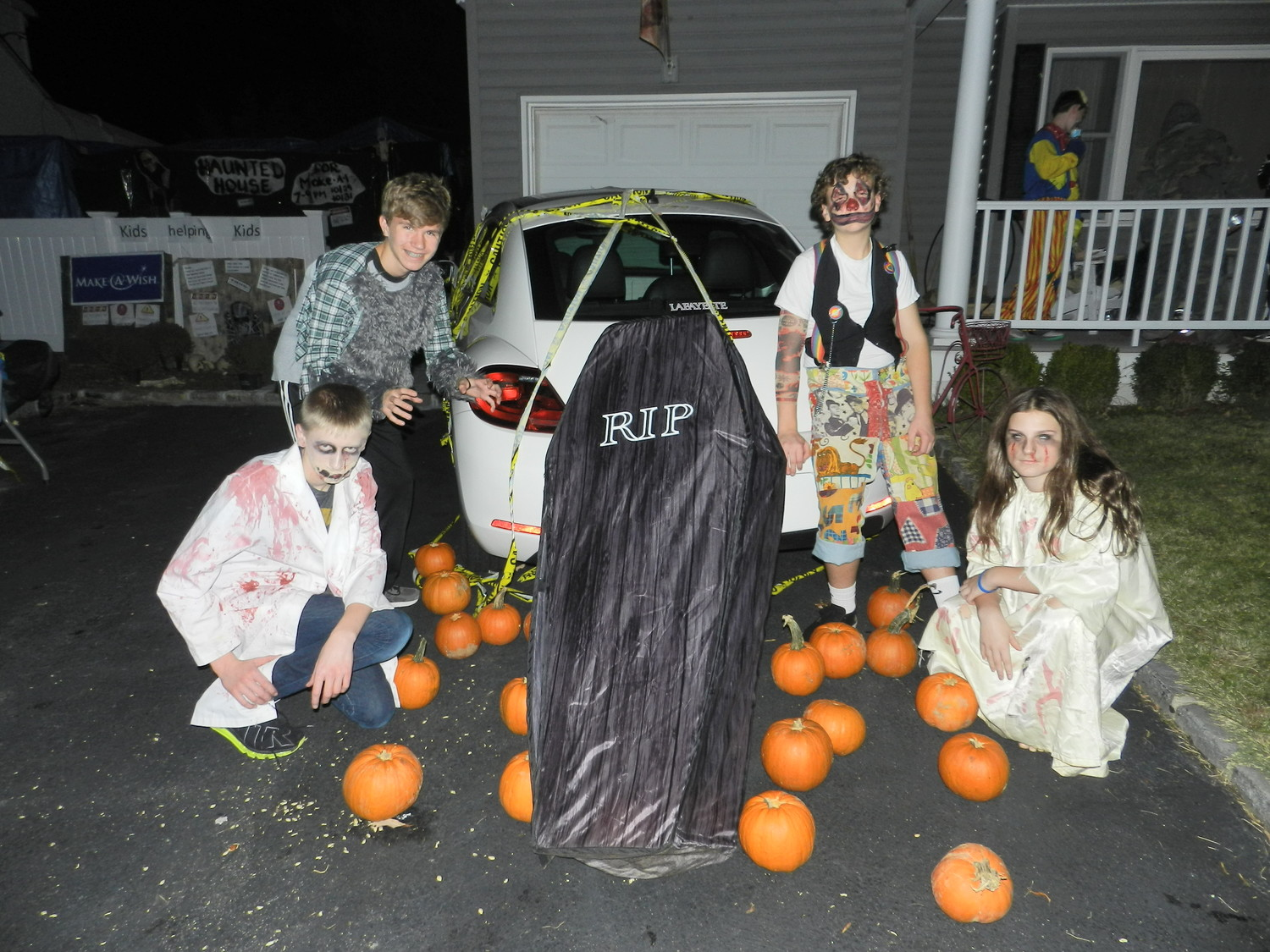 North Shore High School freshmen Robby Brown, left, Mike Heffernan, and Kelly Weber have been a part of Gavin's scare squad since the first haunted house.