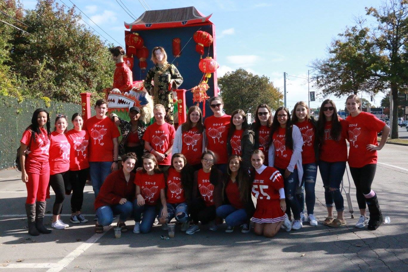 The senior class with their winning Chinese New Year float, featuring mannequins sporting traditional Chinese garb, lanterns, and a dragon.