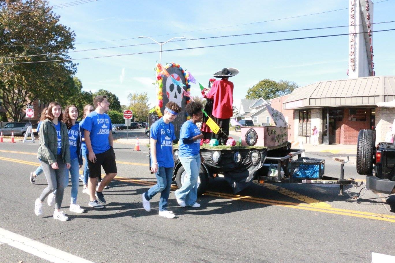A skeleton tried to escape its coffin on the Juniors' Day of the Dead float.