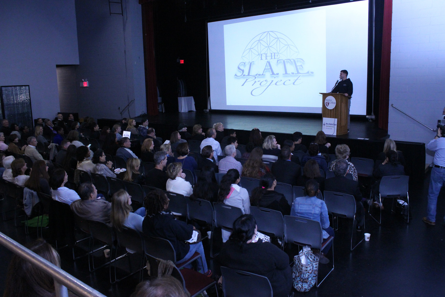 Steven Dodge, who was one of several speakers at an opioid symposium at Molloy College last Saturday, talked about his personal experiences with drug addiction, and his organization, the SLATE Project.