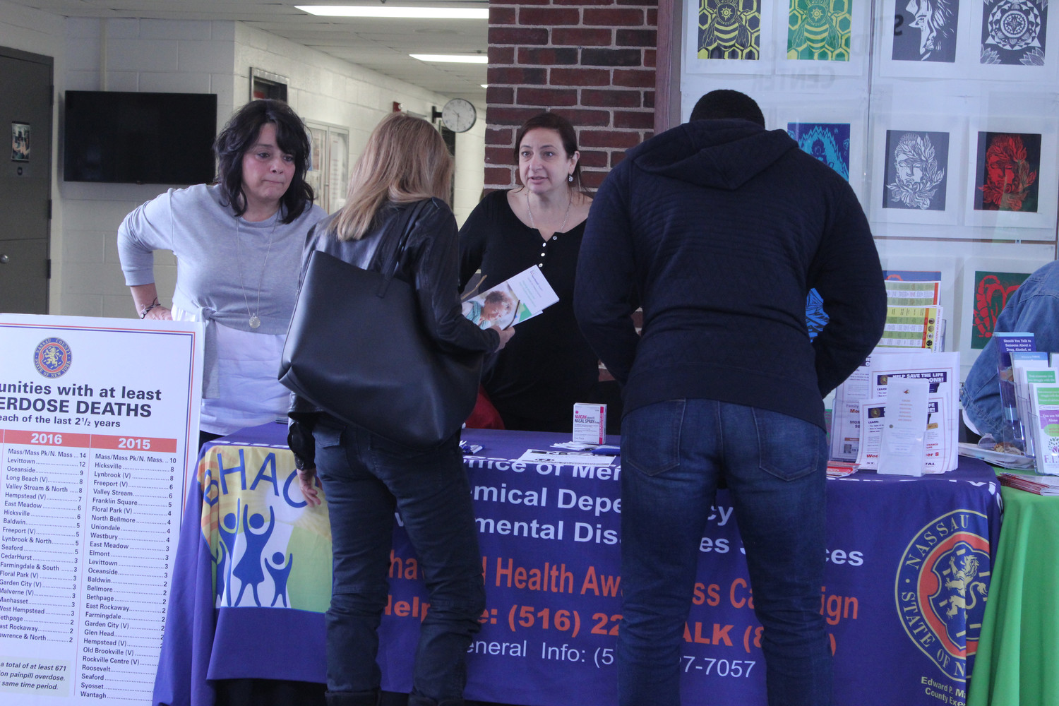 Linda Mangano, far left, along with Eden Laikin, shared information about the programs offered by Nassau County's Behavioral Health and Awareness Campaign.