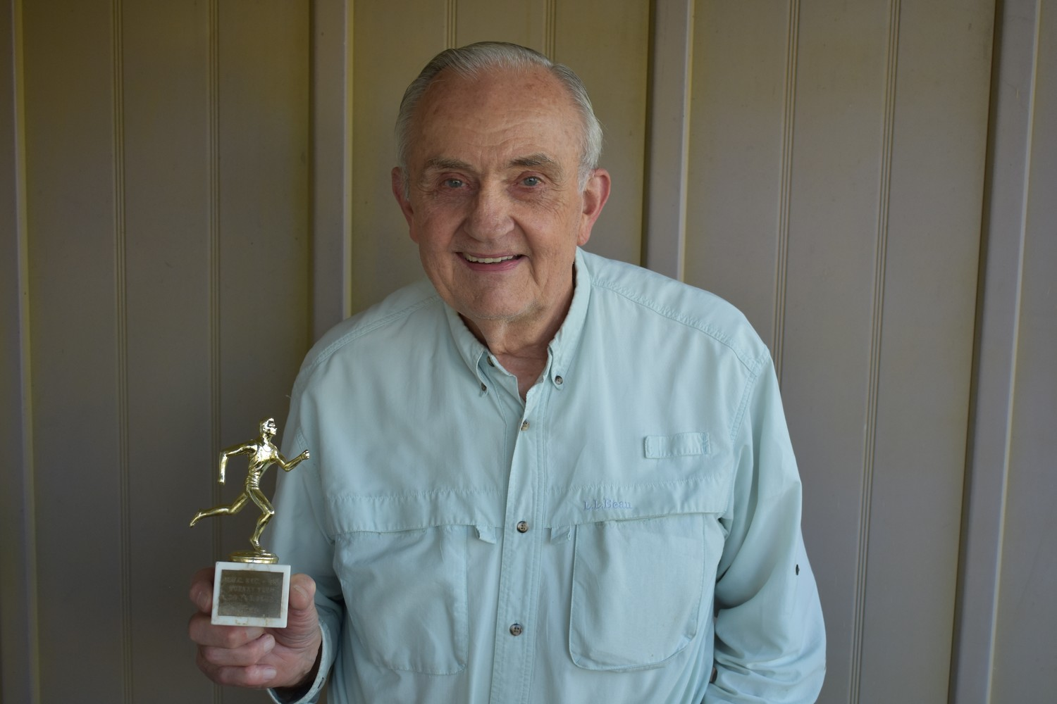 Ted Muellers, pictured with his second-place age group trophy from Rockville Centre's 1968 race, is running in the village-sponsored event for a 50th straight year.