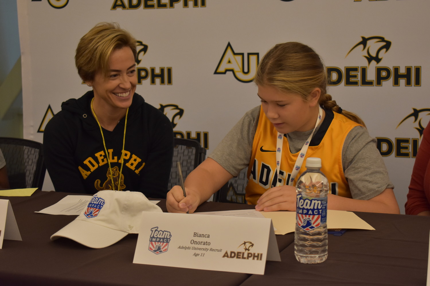 South Side Middle School student Bianca Onorato, 11, signed her letter of intent on Nov. 1 alongside Missy Traversi, coach of the Adelphi University women's basketball team, officially joining the squad through Team Impact, an organization that pairs children suffering from various illnesses with college teams.