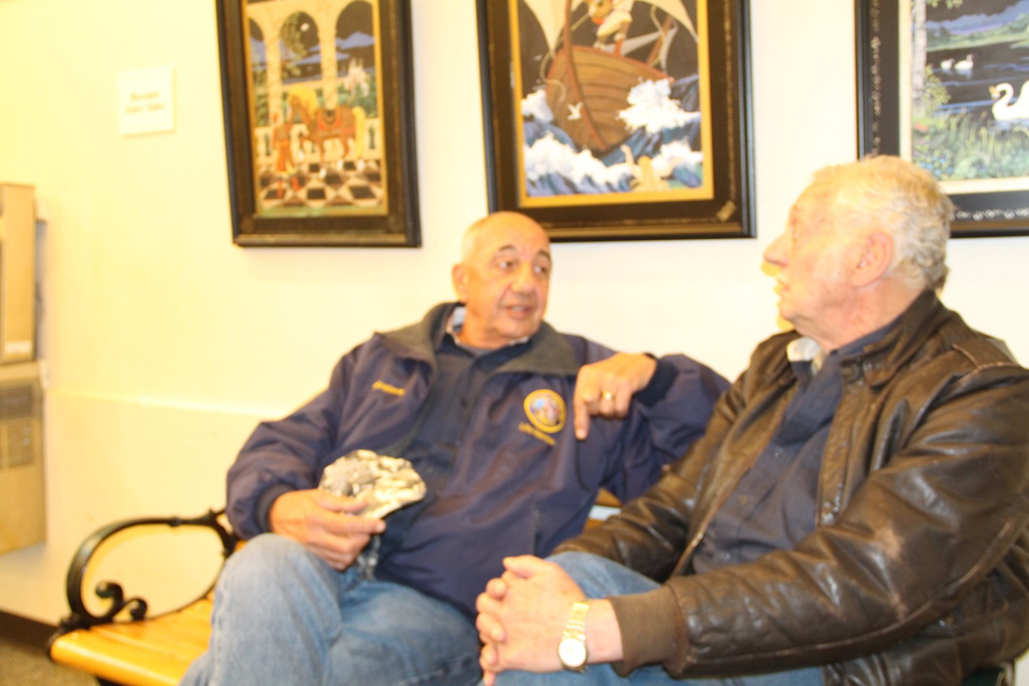 Longtime friend, Sal Rizza, left, from Freeport stopped by to chat with Bill Marinaccio, right, Alexandra Marinaccio's husband during the artist reception.