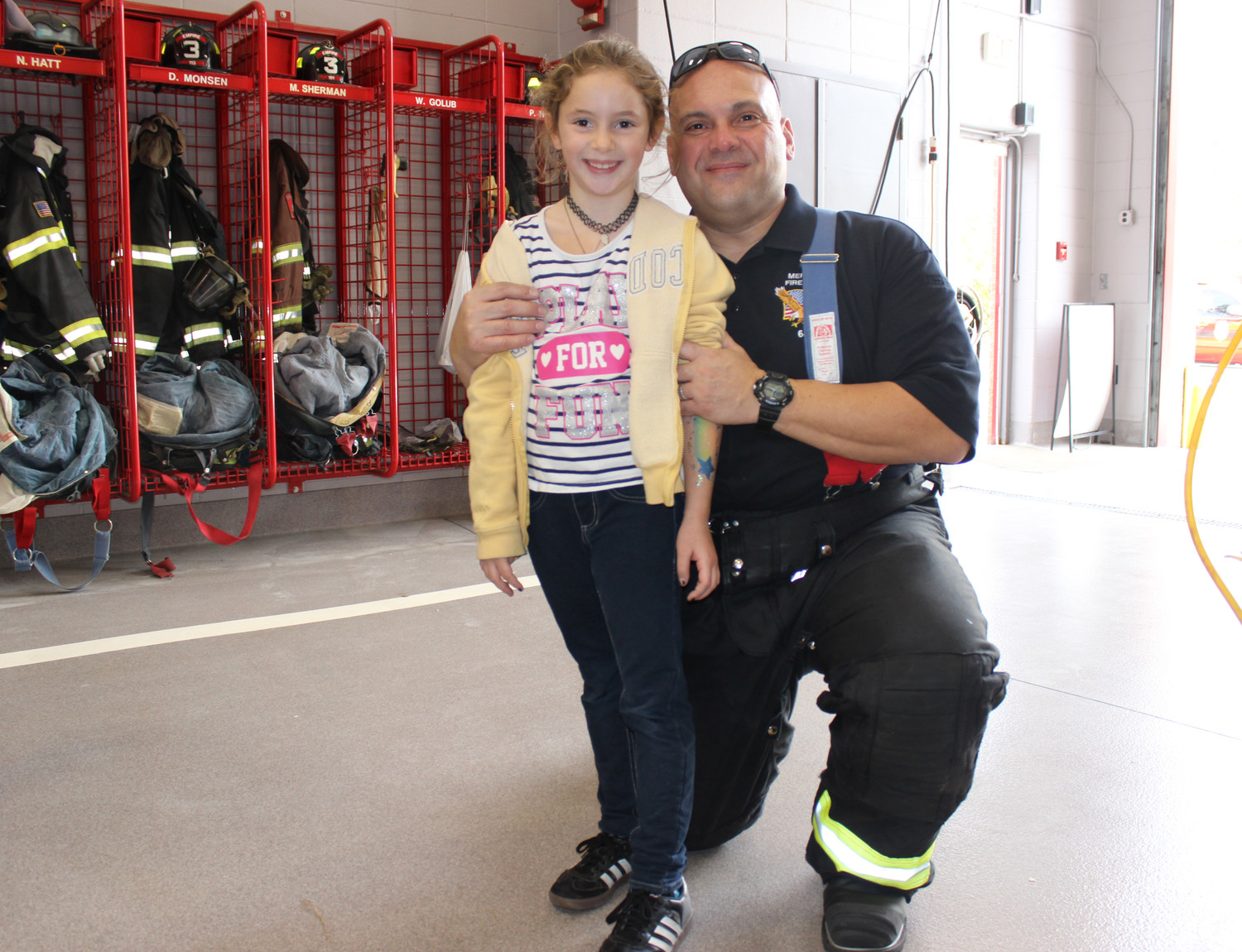 Eric Morales, 46, of Merrick, right, began volunteering for the Merrick Fire Department after its open house last year. He is pictured here with his daughter Megan.