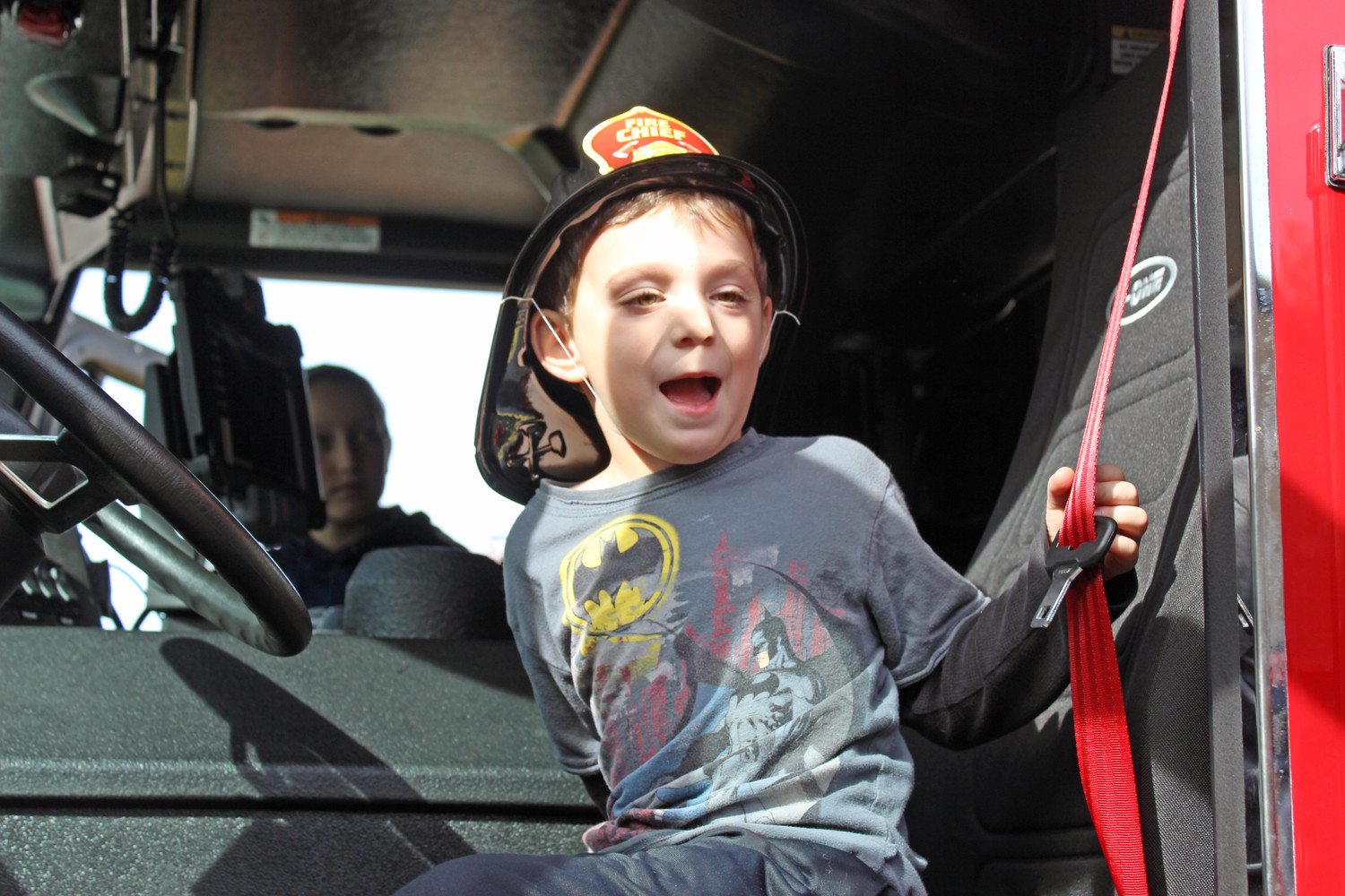 Max Babitz, 4, of Merrick, took a turn sitting in one of the fire department's engines.