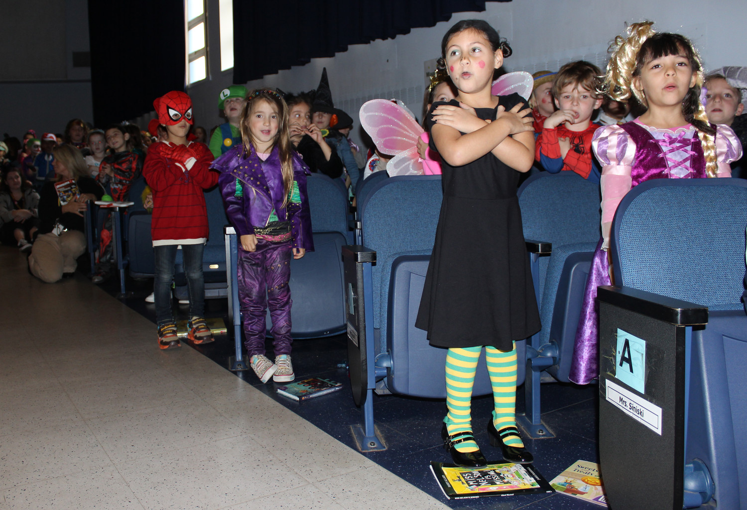 Reinhard students sang various Halloween songs as music teacher Randi Andersen accompanied them on piano.