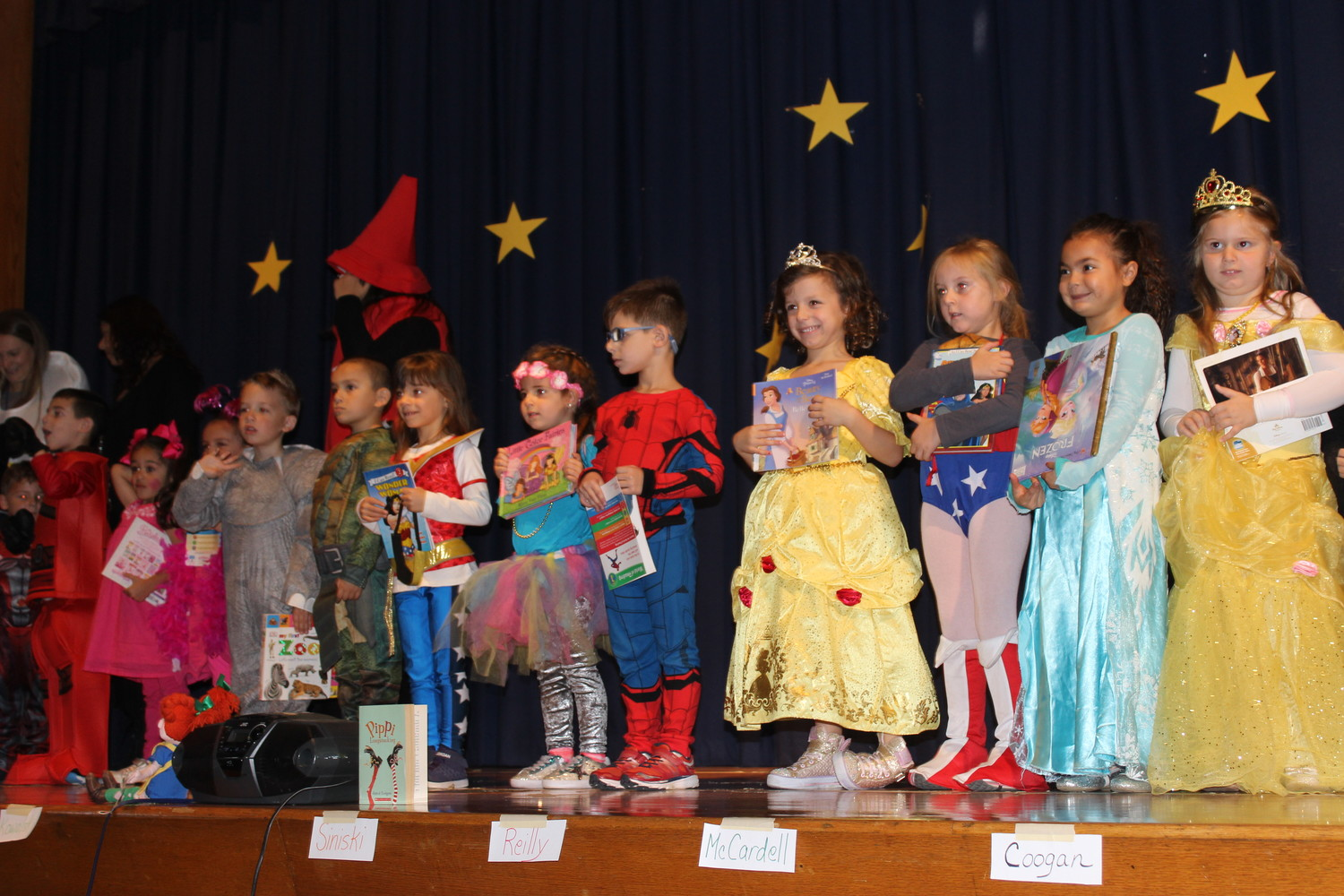 Students at Reinhard dressed as characters from their favorite books and marched through the school's auditorium in front of their parents and siblings.
