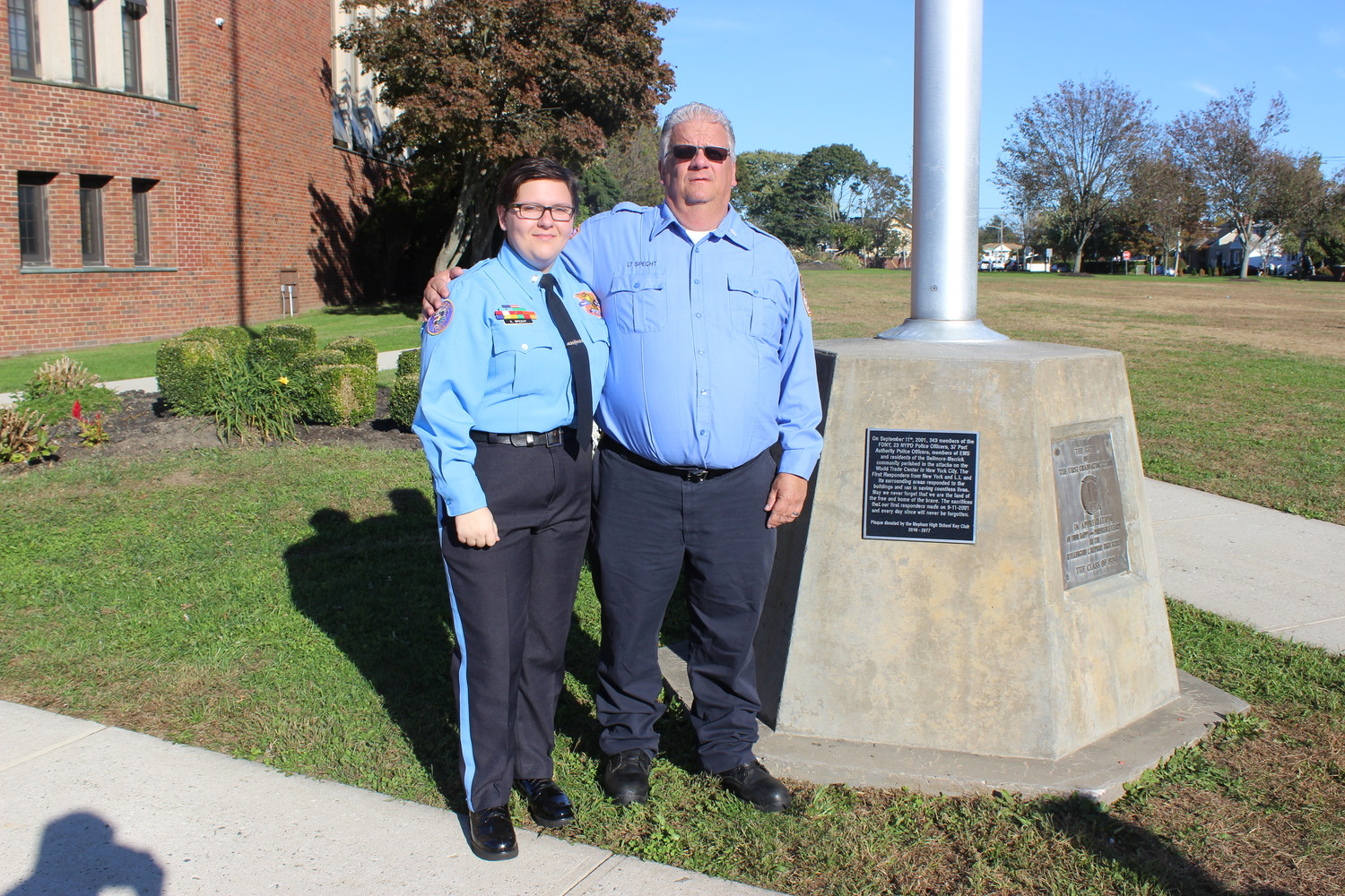 Kayleigh Specht, a senior at Mepham High School and president of its Key Club, spearheaded the dedication of a plaque to commemorate the citizens who lost their lives in the Sept. 11 terrorist attacks. She is also an active member of the Nassau County Police Department Explorers program and is pictured here with her father, of the department, Lieutenant Chris Specht.