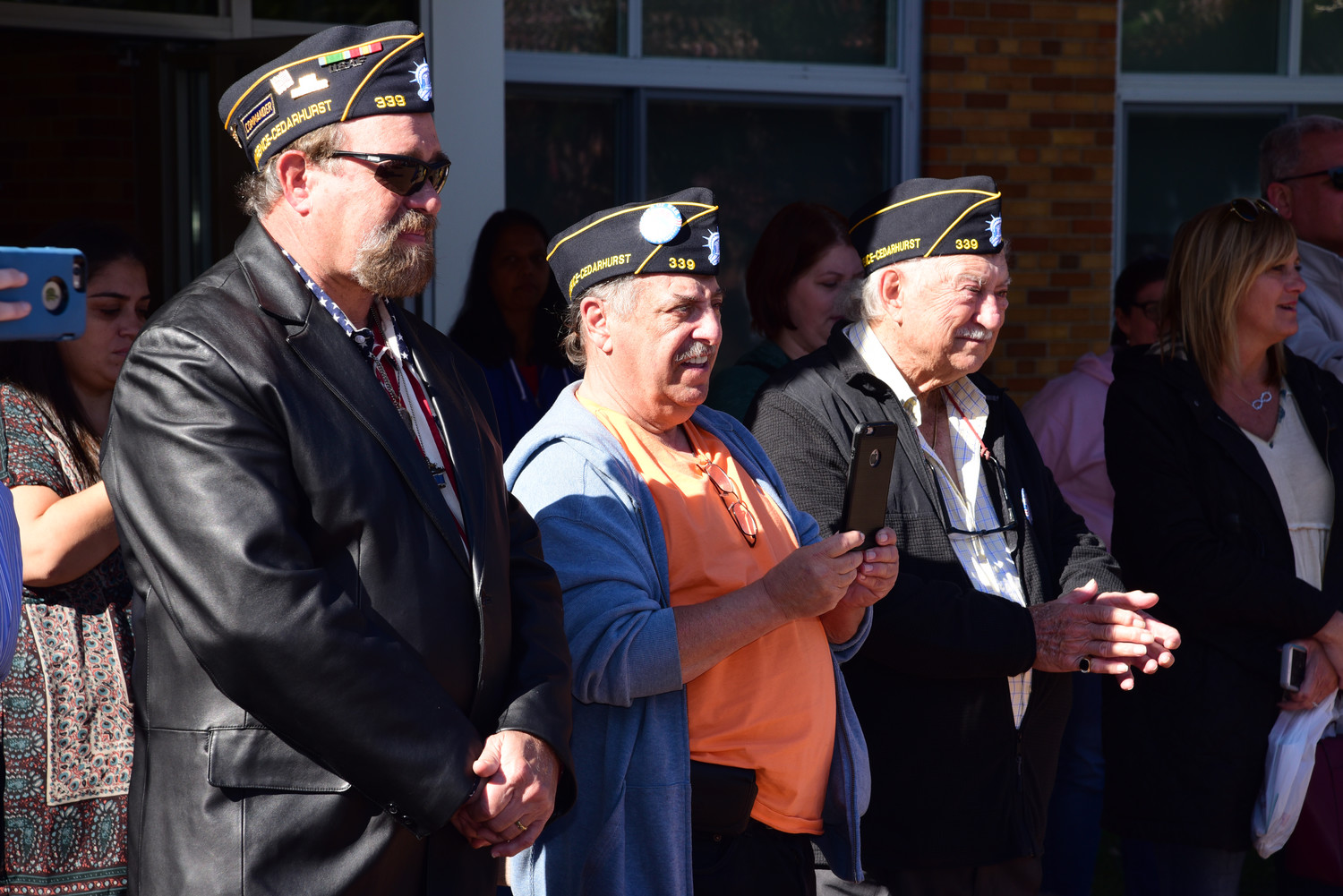At Ogden Elementary School's Make A Difference Day with Paws For War, Lawrence Cedarhurst American Legion Post 339 Commander Syd Mandelbaum, left, and Legion members Mitchell Dancyger and Domenick Crici.