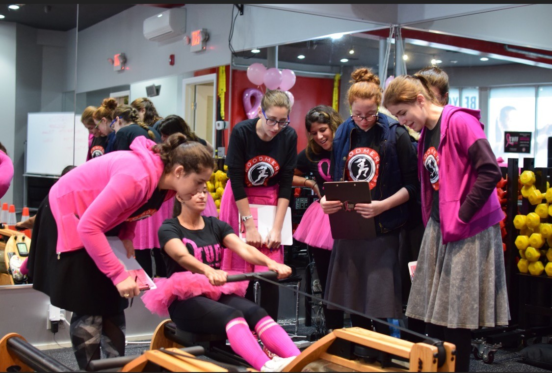 Shulamith High School students helped to fire up competitors in the Ultimate Fit Female Challenge at the Woodmere Fitness Club that raised roughly $5,000 to fight breast cancer.