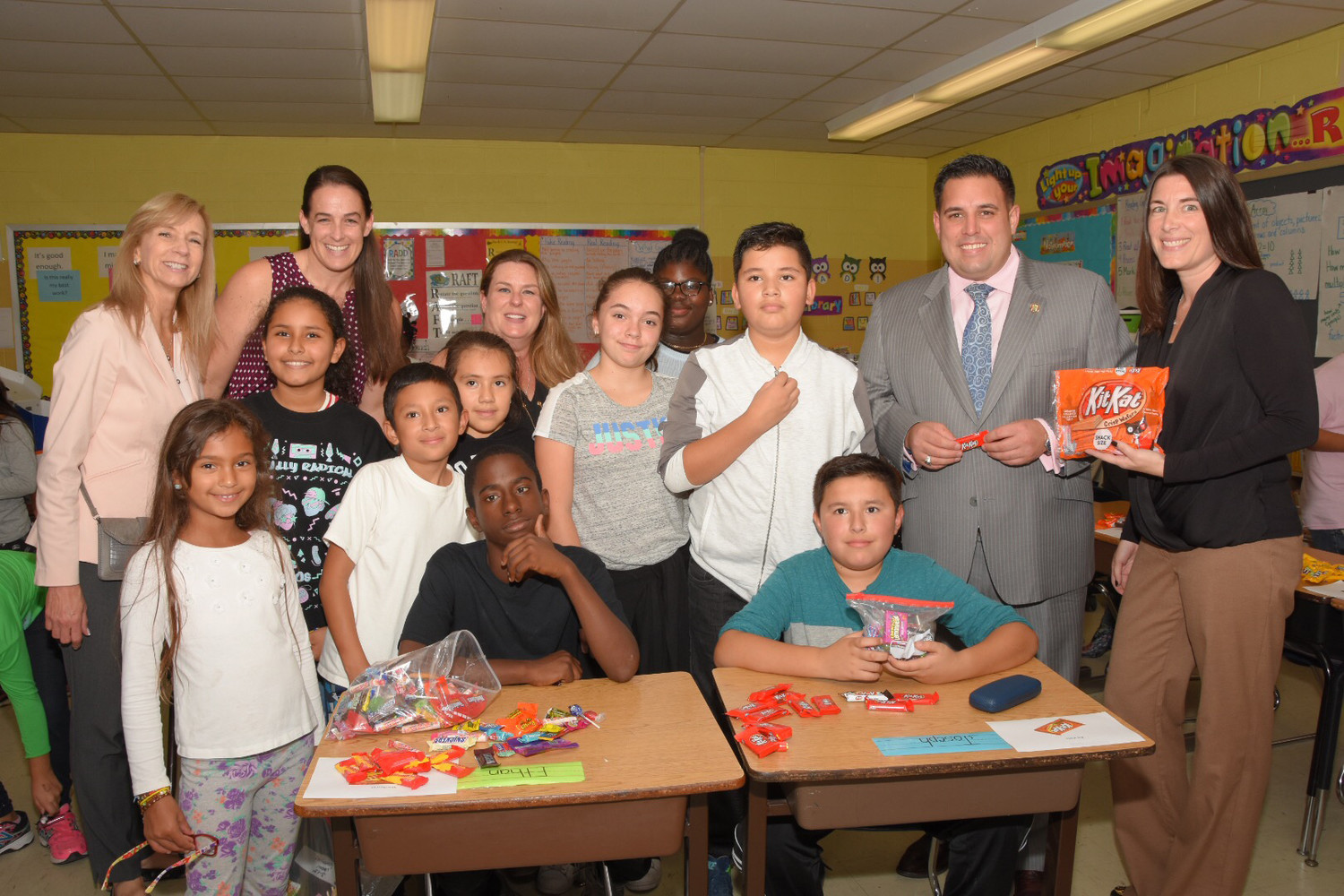 U.S. military personnel will be receiving candy from Lawrence Elementary School students through Operation Gratitude. Standing from left were Rina Beach, Jacqueline Beckmann, Lisa Virula, Mike Arreaga, Bridgette Gordilla, Jennifer Talenti, Gina Pasquariello, Kenniyah Wallace, Christopher Cornejo, Councilman Anthony D'Esposito and Kathleen McDonough. In front from left were Frankie Cancelliere, JaWan Groover and Carlos Reyes.