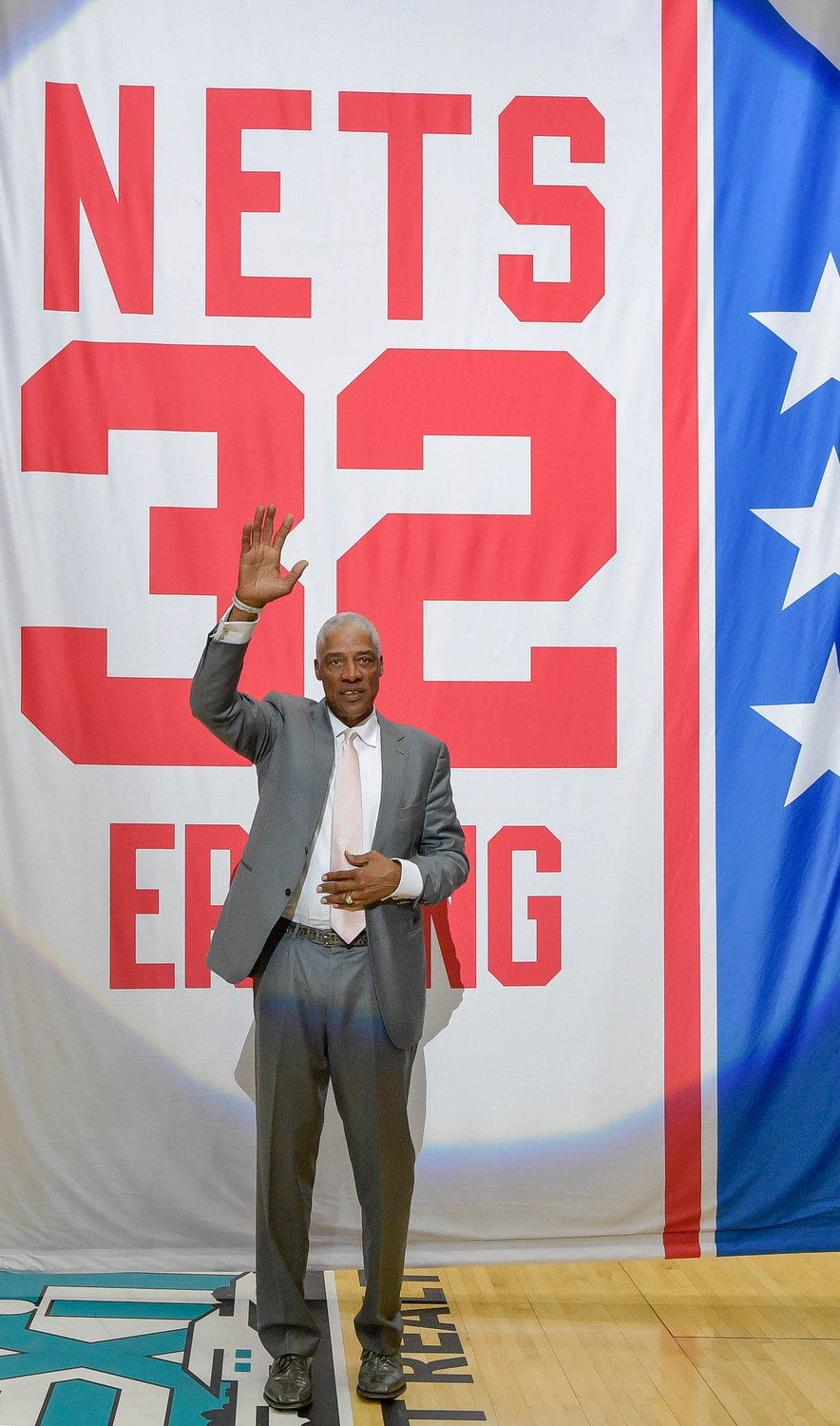 "Julius ""Dr. J"" Erving's No. 32 was raised to the rafters prior to the Long Island Nets' opener."