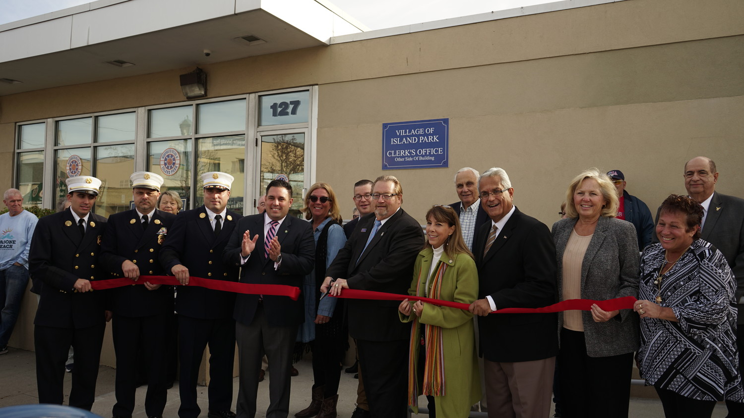 Elected officials came out in force to celebrate Island Park's Village Hall ribbon cutting ceremony.