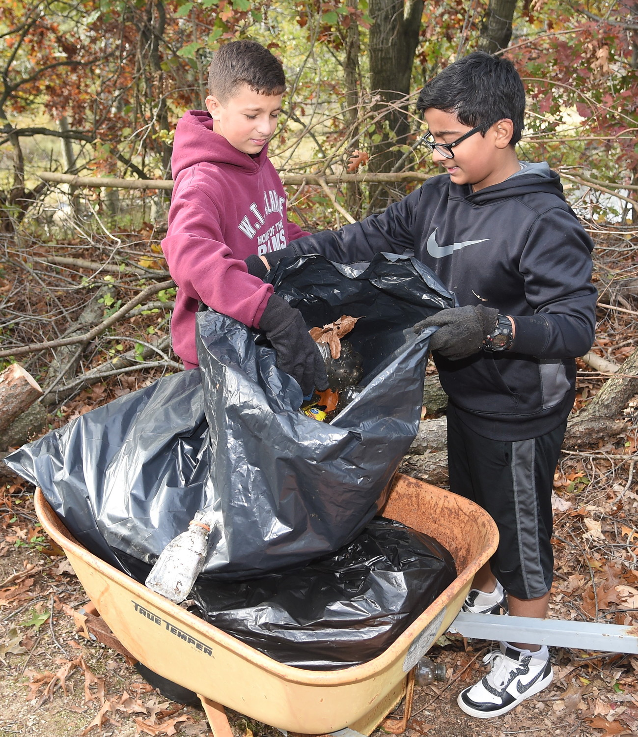 Antonio Palmeri and Sidd Chiguripati used a wheelbarrow to stuff garbage bags to the brim with as much litter as possible.