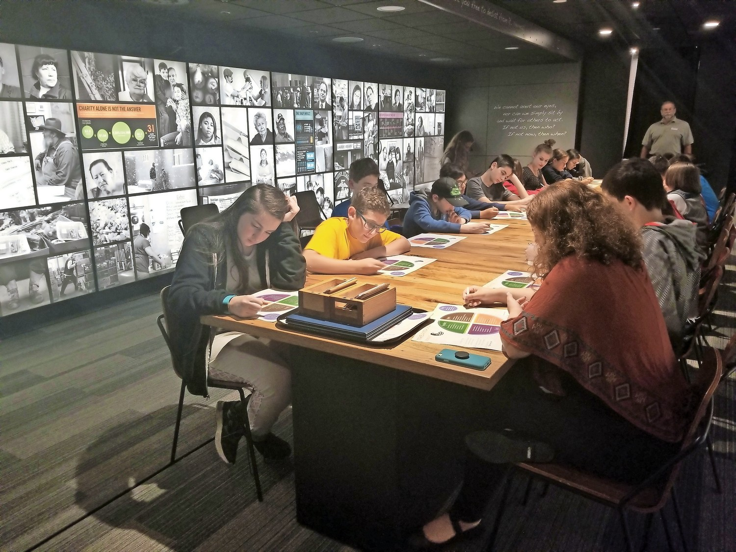 "Seventh-and eighth-graders from East Meadow's Temple Emanu-El and Wantagh's Temple B'Nai Torah visited the touring exhibit, ""This is Hunger,"" on Monday."