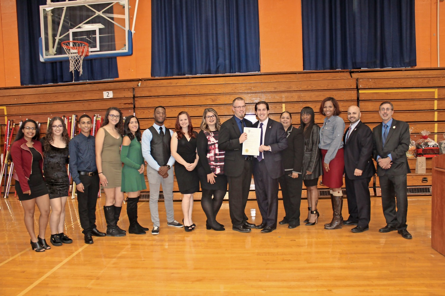 The Malverne High School band celebrated its recent success in state competition. State Sen. Todd Kaminsky, sixth from right, presented a citation to band director Glen Johnson.