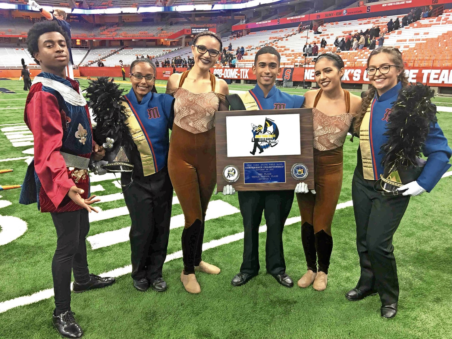 Members of Malverne High School's marching band, drama club, and flag twirling crew that included, from left, Brandon Joseph, Subhadra Debnath, Gabrielle Monogioudis, Alex Mendez, Angie Duran and Olivia Valentino were proud to finish third at the NYSFBC.