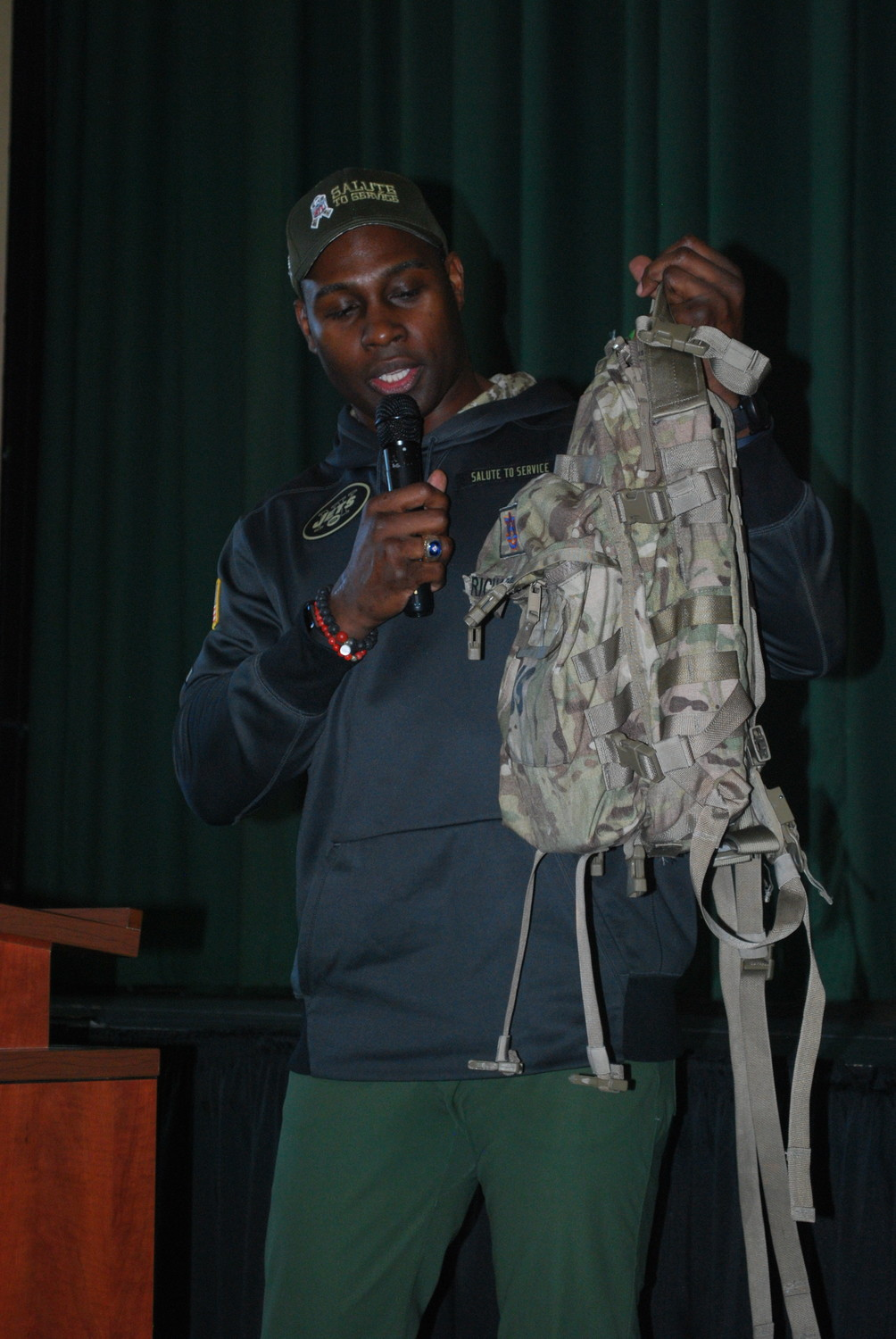 Former NFL player Tony Richardson showed his sister's military backpack to students and faculty at HAFTR High School on Nov. 10.