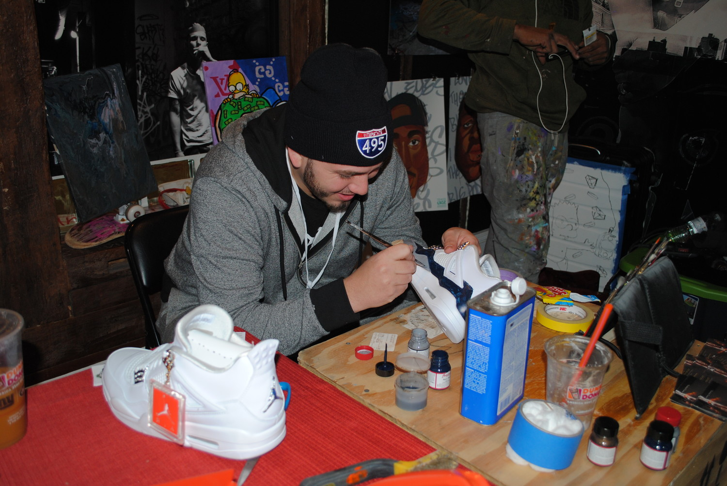 Dominick Brasiello, owner of Clean Kicks Long Island in Glen Cove, painted a custom sneaker at his booth in the First City Project house.
