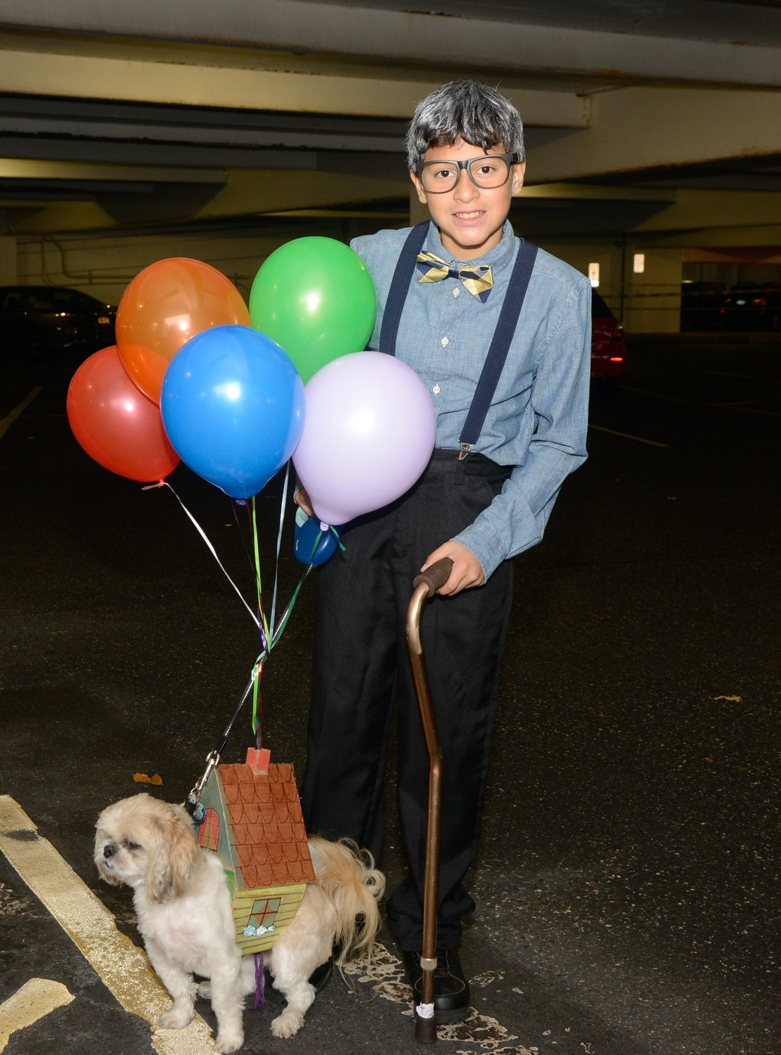 "Two creative contestants dressed as Carl and the house from the movie ""Up."""