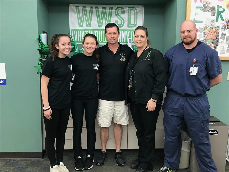 Tommy Maher, center, with his daughter Kelli, to his right, and her friend Aline, visited Henry County Medical Center in Tennessee on Nov. 8 to honor Sonny Melton, a victim of the Las Vegas mass shooting. Director Deanne Berry, and Phillip, one of Sonny's co-workers, joined them.