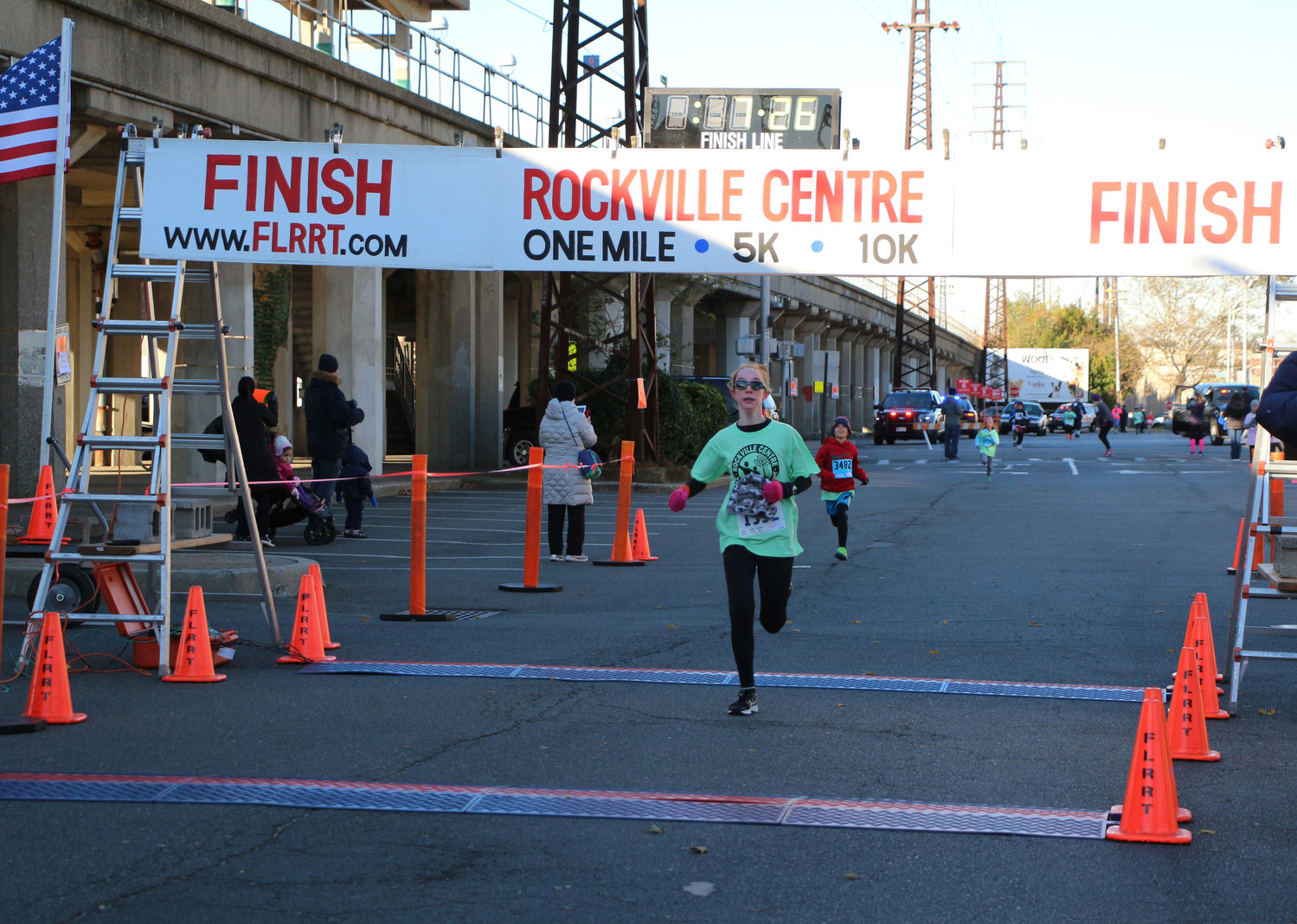 The first runner to finish the one-mile run was 13-year-old Kathy Srobhan, at 7 minutes and 26 seconds.