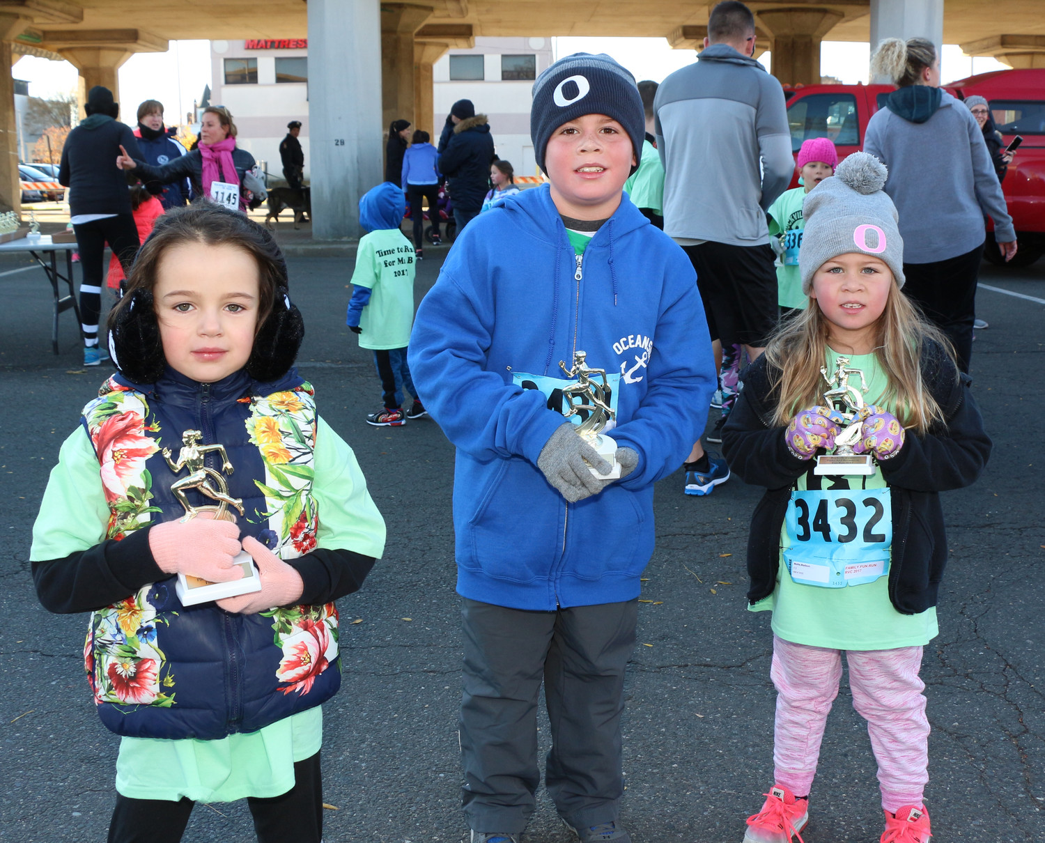 Cleo Lipatov, 6, Mike Molite, 8, and his five-year-old sister, Madison, finished the race.