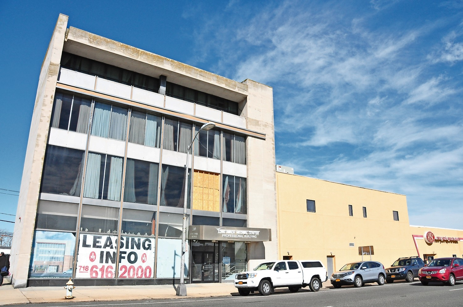 A developer is seeking tax breaks to convert a vacant building at 249 E. Park Ave., pictured, into rental units.