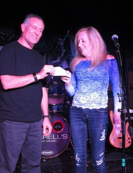 On Nov. 5, the Arnel's gave $675, their first donation, to Wendy Caldwell, the founder of A New Beginning Animal Rescue in Plainview.