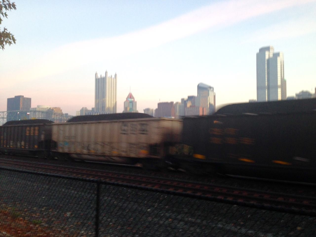 Coal has long defined the Pittsburgh region. Above, a coal train rumbles by, across the Monongahela from the downtown.