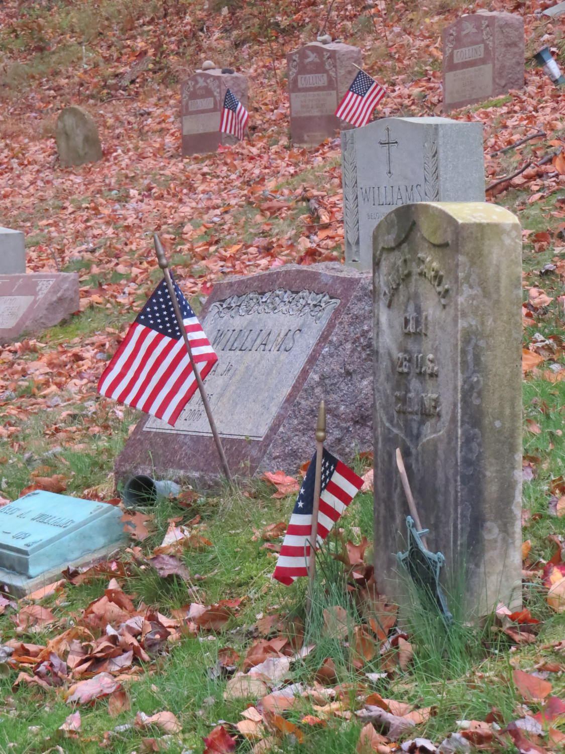 Civil War veteran David Carll's grave, right, sits next to those of other veterans at Pine Hollow.