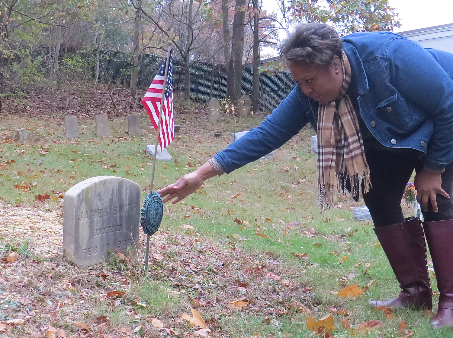 Denise Evans-Sheppard moved a General Army of the Republic marker, given as an honor of military service, at one of the graves of a veteran.