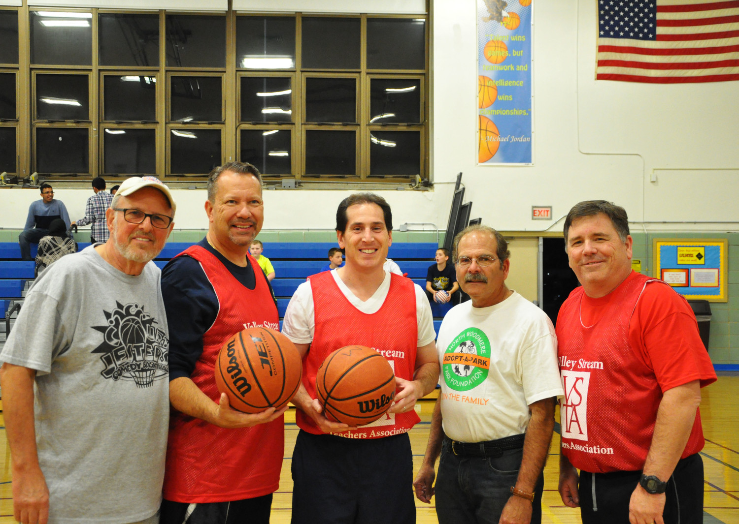 Larry Parker, left, from the Court Jesters, Valley Stream Mayor Ed Fare, State Sen. Todd Kaminsky, Nassau County District Court Judge candidate Gary Carlton, Valley Stream Teachers' Association President Rich Adams gathered for the game on Oct. 27.