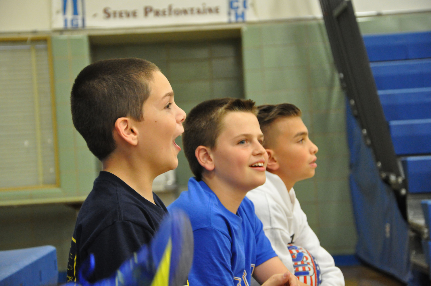 Patrick Crowe, left, Liam Glynn and Nicholas Decker enjoyed the game from the sidelines.