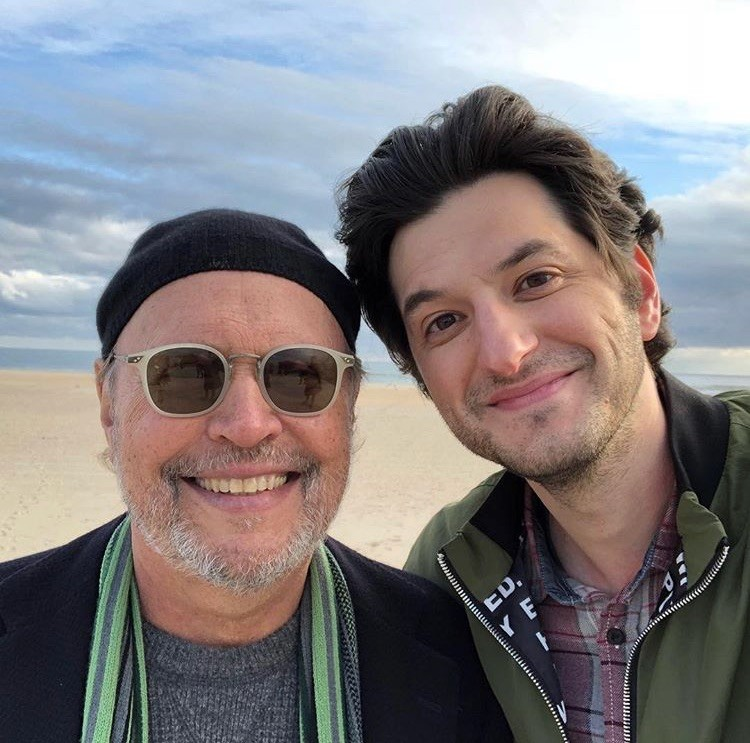 "On Nov. 9, co-star Ben Schwartz, right, posted an Instagram photo with Crystal on the beach with the caption, ""Two NY boys making a movie."""