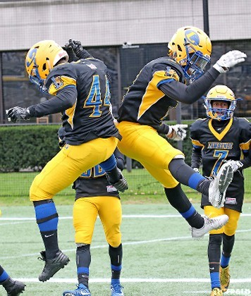 Lawrence's Keijohn Graham, left, and Jordan Alexander celebrated after Alexander's go-ahead touchdown late in the third quarter sparked the Golden Tornadoes to a 21-10 win over Wantagh.