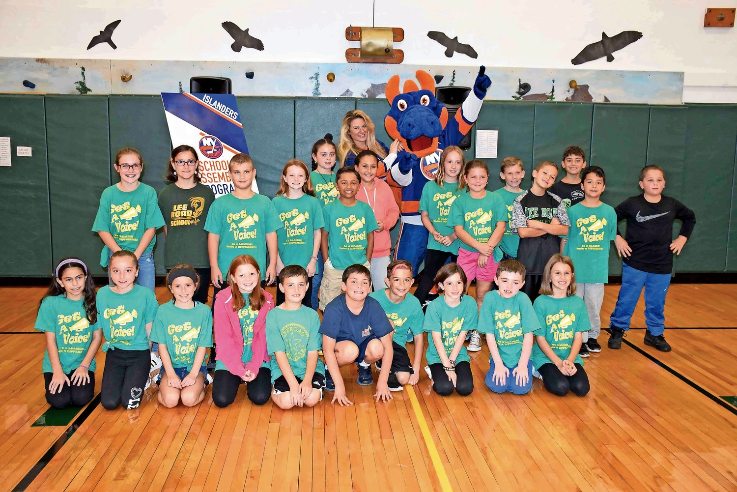 Fourth-grade students at Lee Road Elementary School celebrated the 10th year of its Get-A-Voice Character Education Program on Oct. 24. New York Islanders representative Dina Tsiorvas and mascot Sparky the Dragon attended the kickoff.
