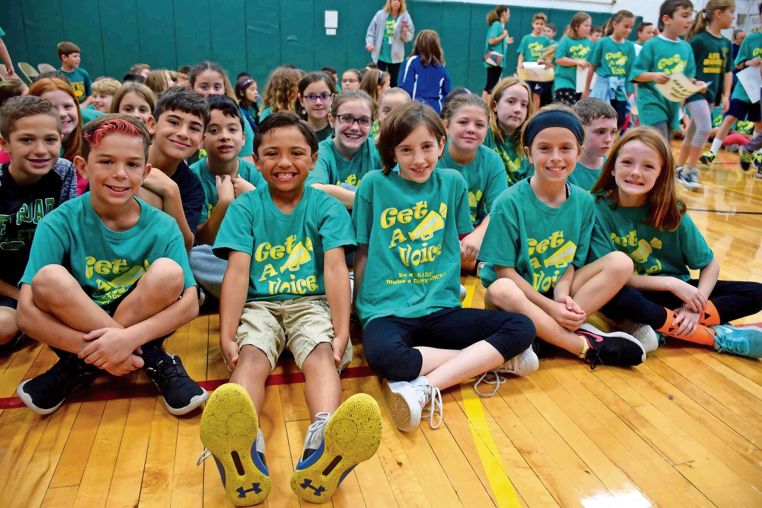 Lee Road Elementary School students dressed in matching T-shirts during the Get-A-Voice Program kickoff.