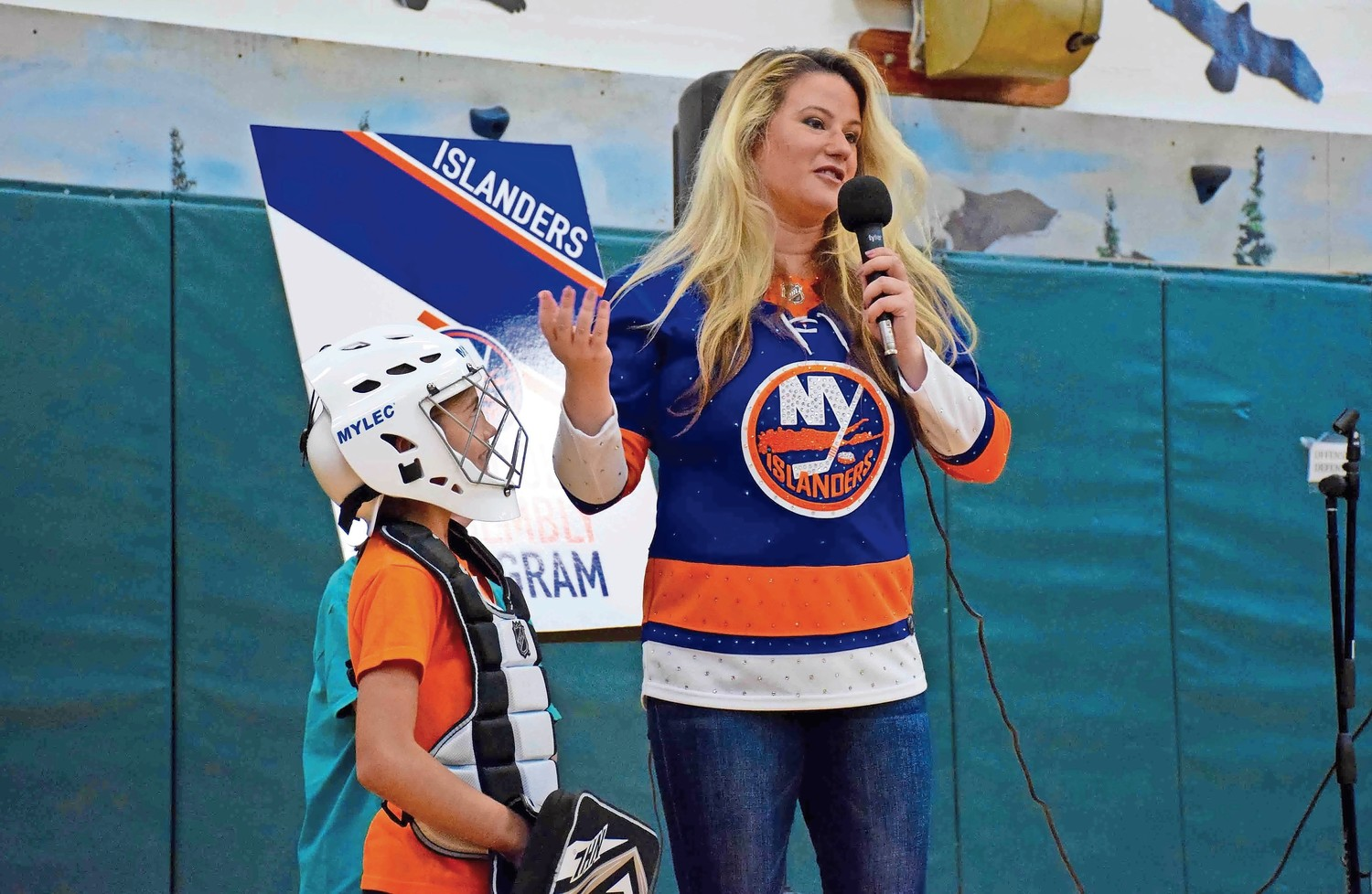 Dina Tsiorvas, a representative from the New York Islanders, spoke about teamwork while third-grader Victoria Boccil looked on.