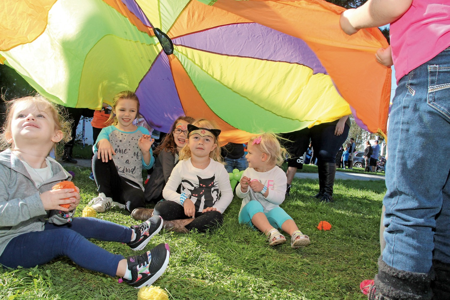 Children in the Pixie Nursery School program had some fun under a parachute on the front lawn of Wantagh Memorial Congregational Church.