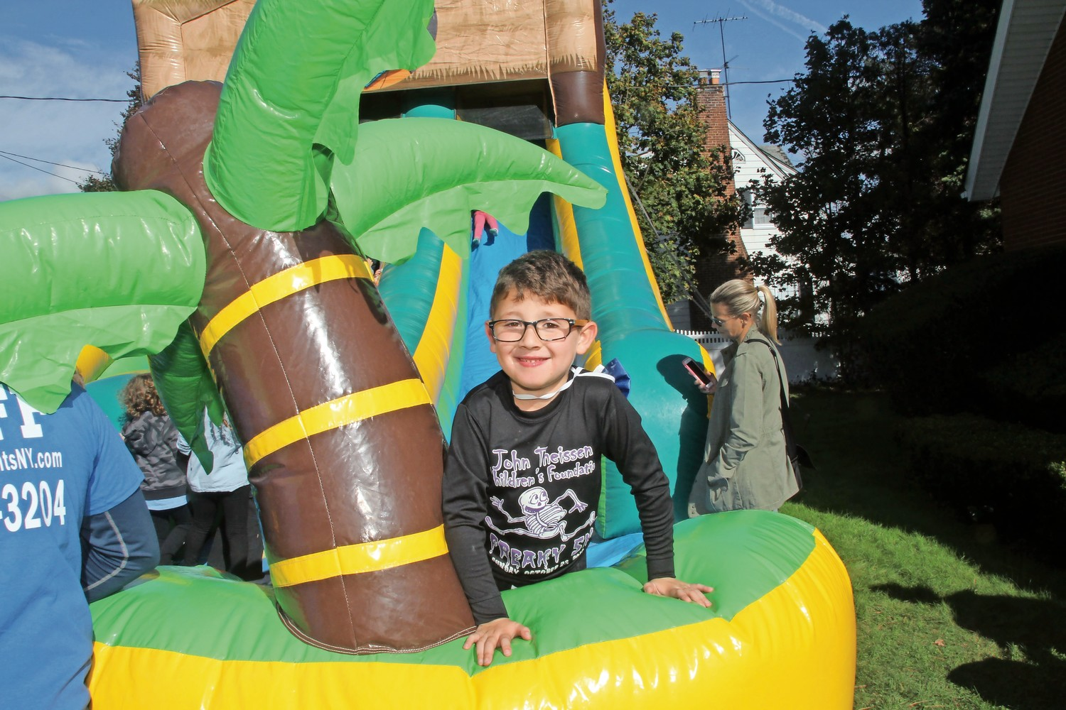 Louis Pierce, 6, enjoyed his time on an inflatable slide at the harvest fair.