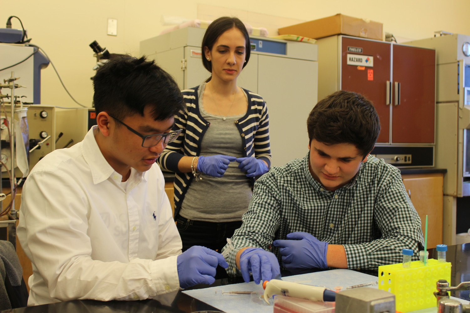Hugh Cheun, left, and Andrew Brinton, sophomores at Kennedy High School, worked with LIU Post undergraduate Susanna Mirabelli on an experiment on clinical biology.